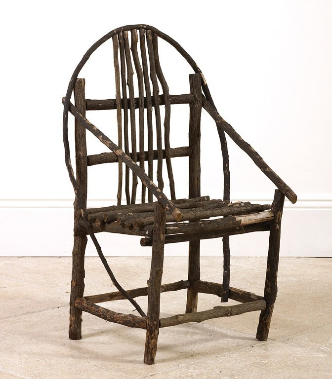 11: A folk art chair formed of branches 73cm high
