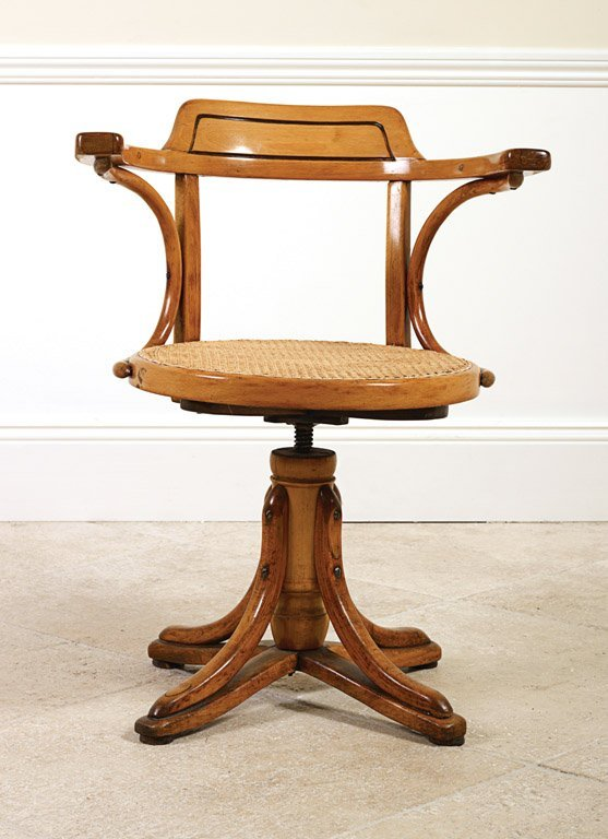 12: A Bentwood and cane revolving captain's chair, Aust