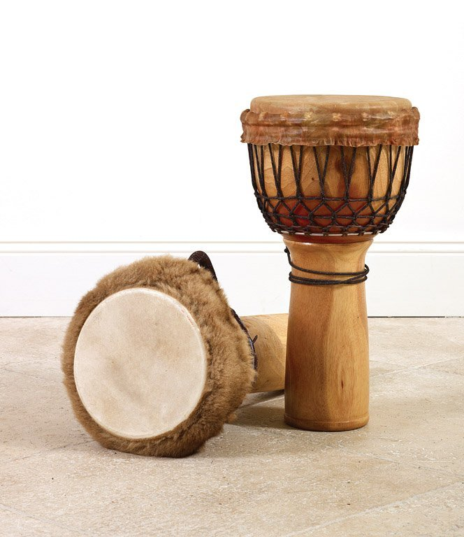 20: A pair of hide, fur and timber drums 61cm high, 34c