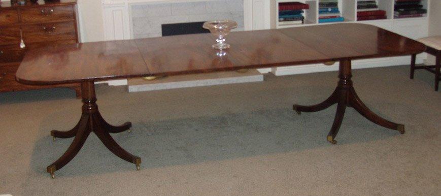 5: A George III style mahogany twin pillar dining table