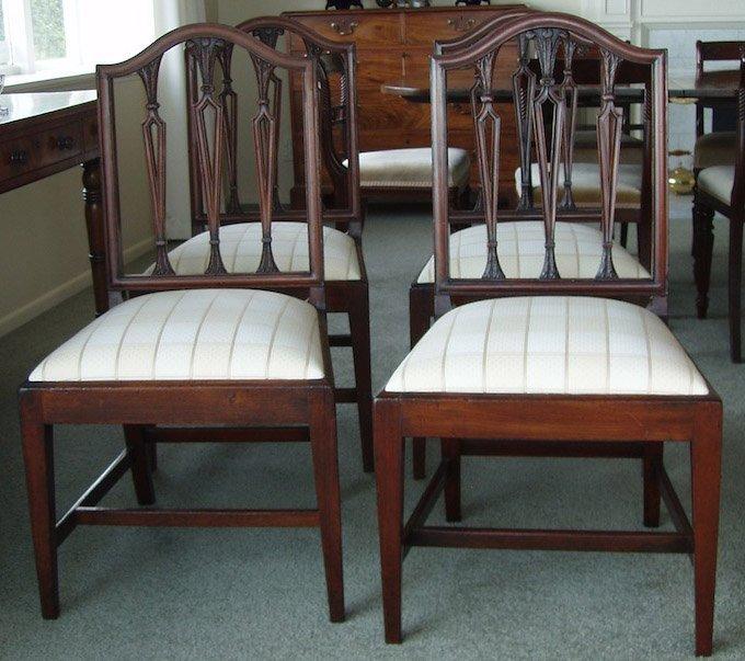 7: A set of four George III mahogany Hepplewhite style