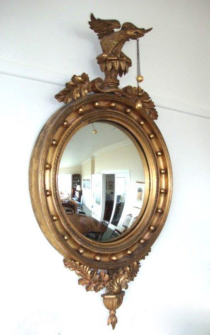 10: A Regency gilt wood convex wall mirror, English, ci