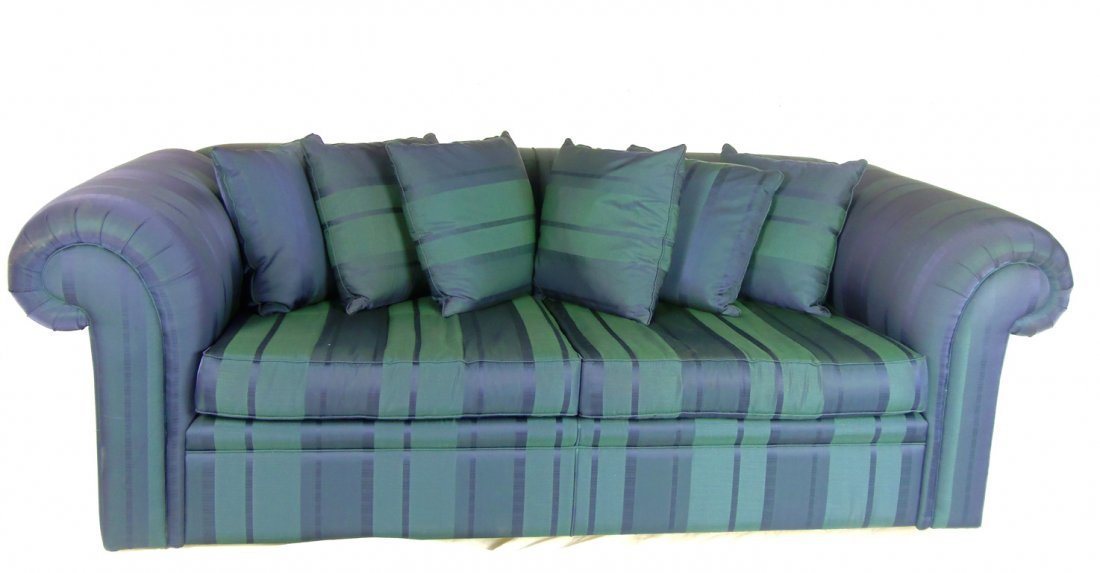 14: A blue three-seater Chesterfield type sofa approxim