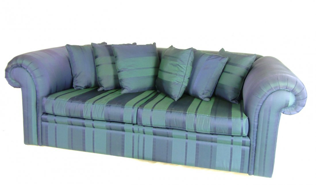 15: A blue three-seater Chesterfield type sofa approxim