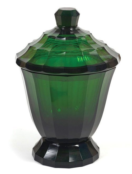 17: An emerald green glass covered vase in the style of