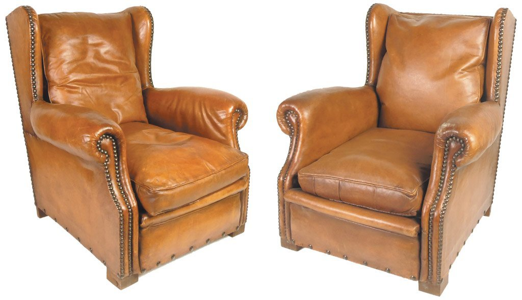 22: A good pair of tan leather wing armchairs, French,