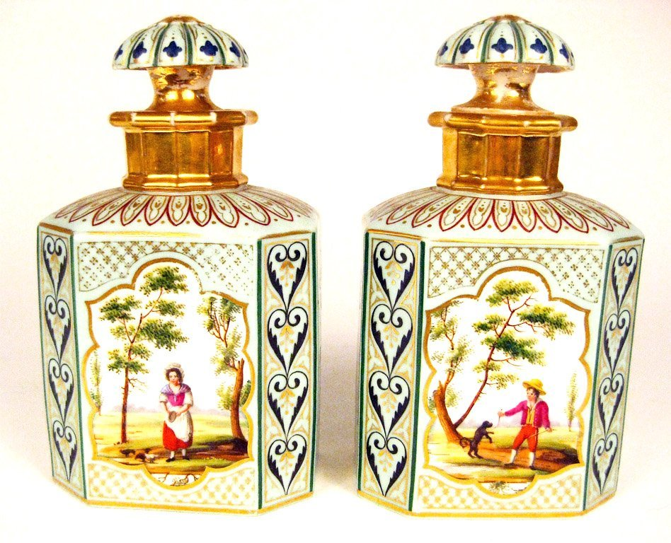 23: A fine pair of finely painted porcelain flasks, Fre