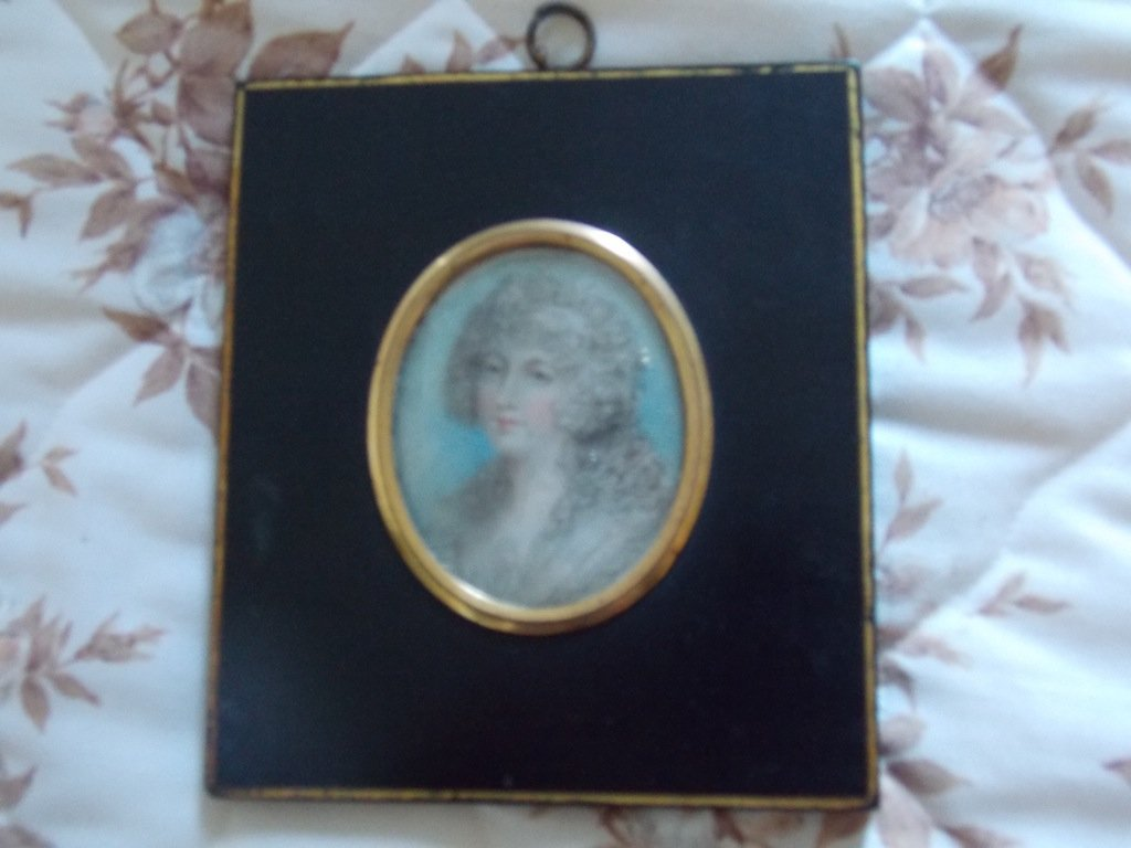 16: A portrait miniature on ivory of a young lady  oval
