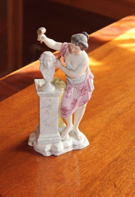 20: A 19th century Dresden figure of a sculptress with