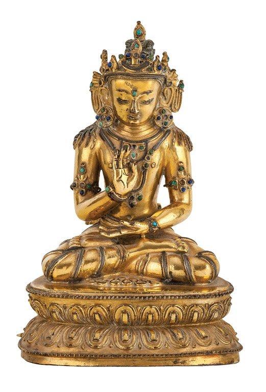 540: A very fine and rare Tibetan gilt-bronze silver in