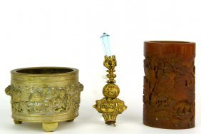 543: Three objects; A gold and blue glass hat finial; a