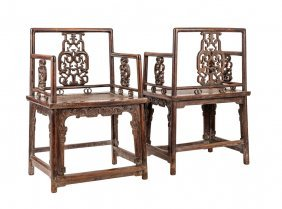556: A fine and pair of Chinese Huanghuali armchairs in