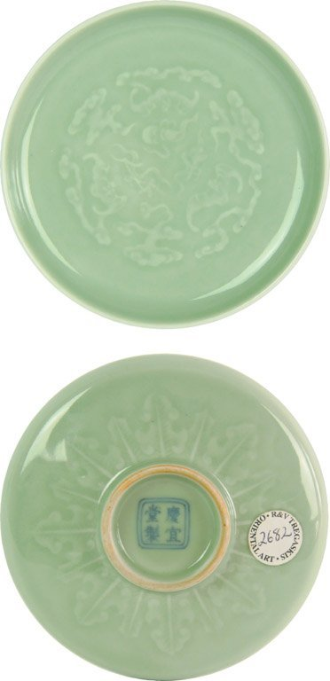 557: A Chinese pale green celadon glazed small dish, Qi