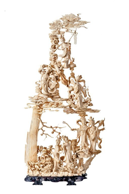 A finely carved Chinese large ivory group of Immortals