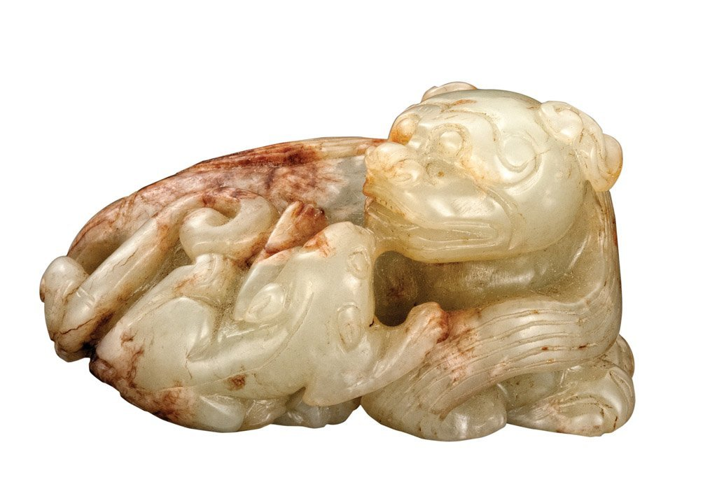 A Chinese Pale Celadon and russet jade group, Ming dyna