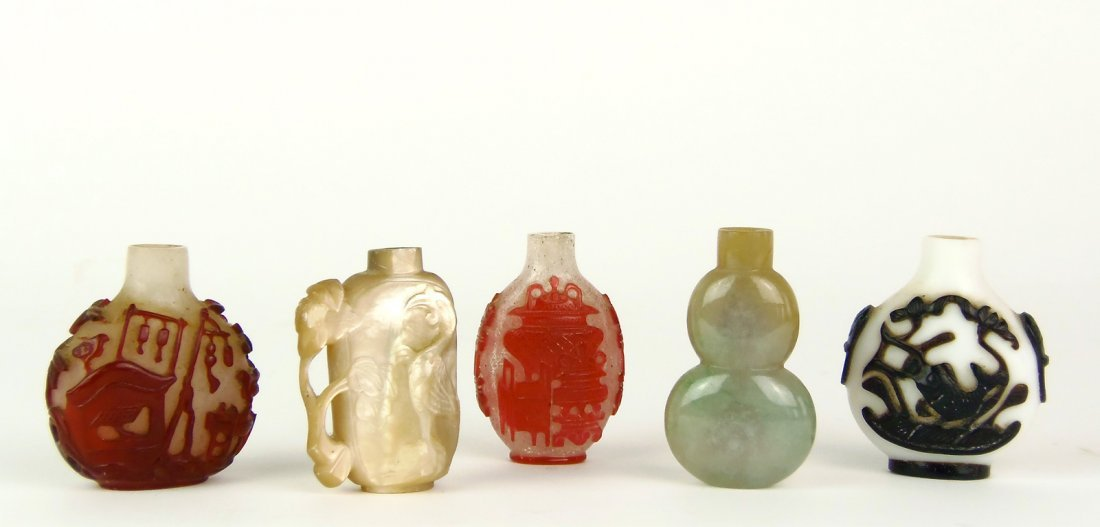 Five Chinese snuff bottles , three in overlay glass; on