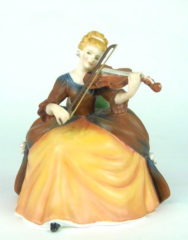 A Royal Doulton figurine, Violin by Margaret Davies HN2
