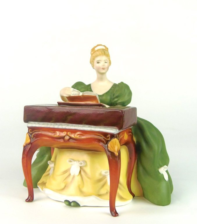 A Royal Doulton figurine, Virginals by Margaret Davies