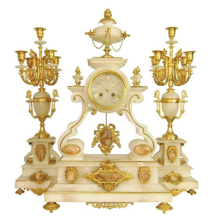 A gilt bronze mounted alabaster clock garniture, French