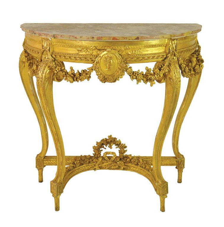 A gilt wood marble top console table in the Louis XVI s