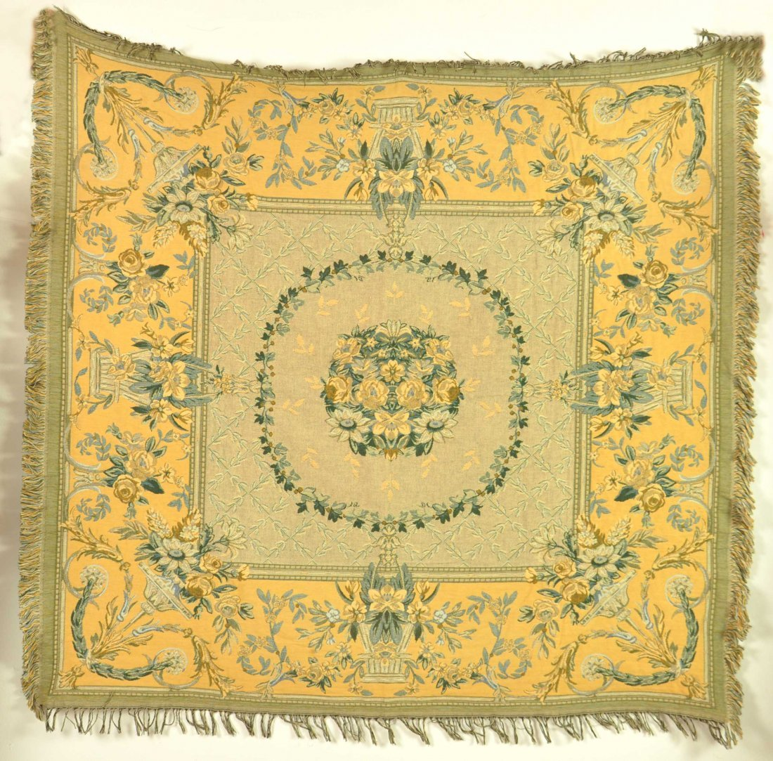 A yellow ground tapestry panel woven with flowers appro