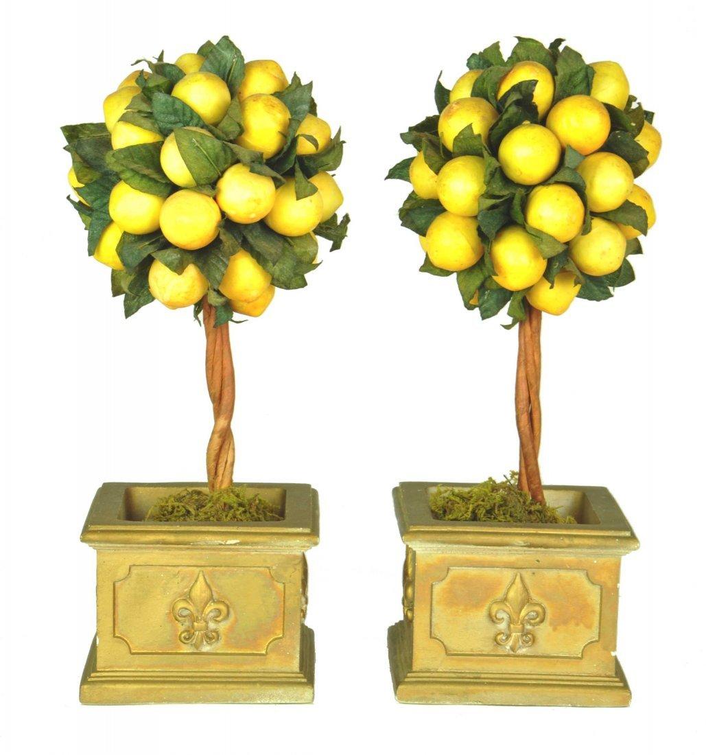 A pair of miniature gilt planter boxes with faux lemon