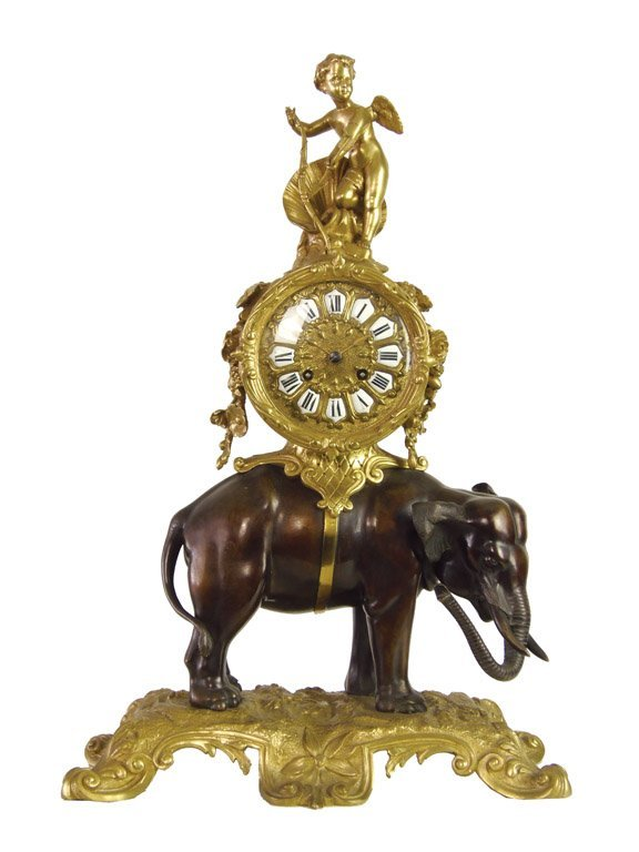 A Louis XV style bronze and gilt bronze elephant form c