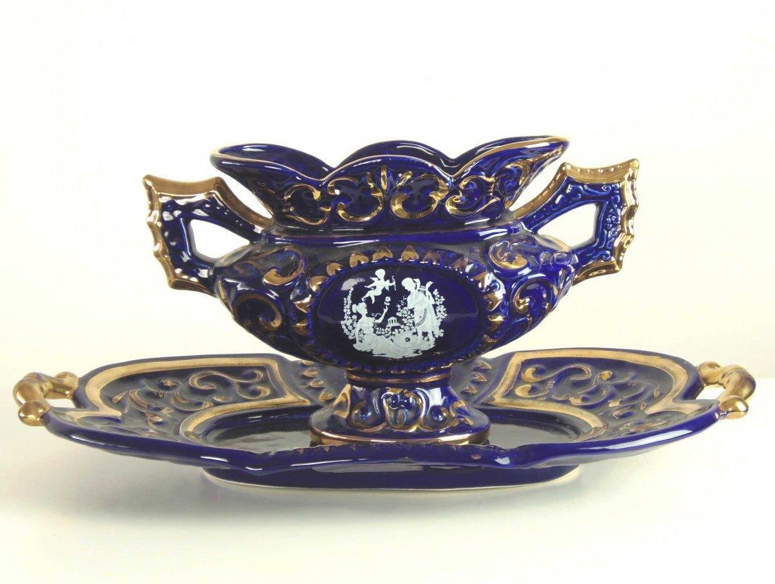 A gilt blue and pate-sur-pate decorated pedestal bowl a