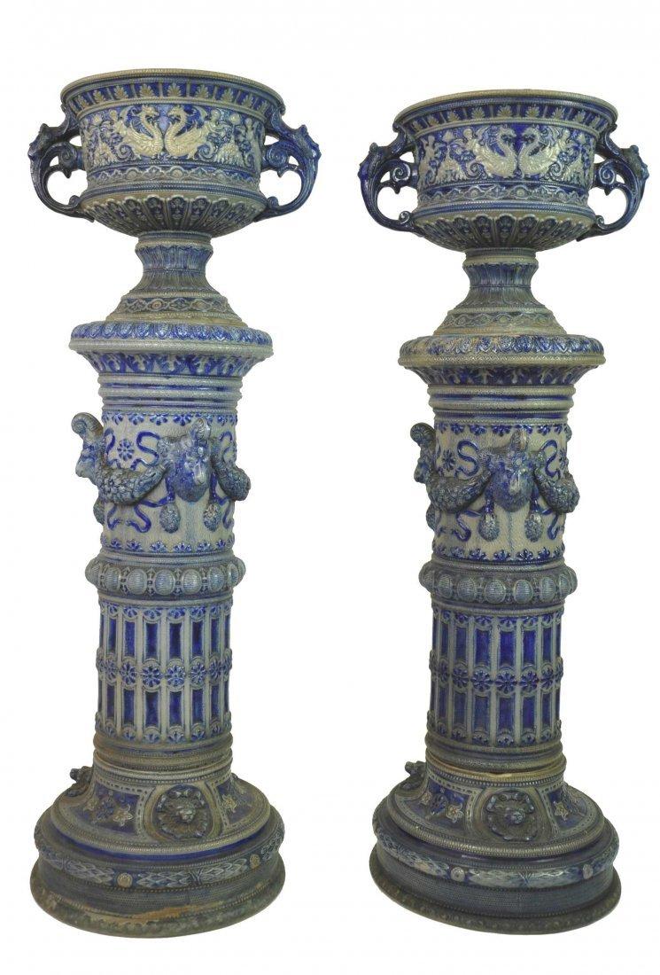A pair of Rhenish pottery jardinières on pedestals, Ger