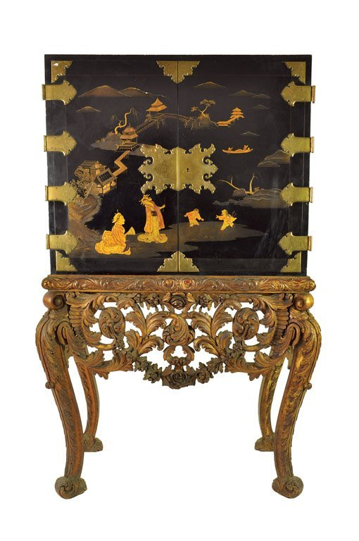 A black Chinoiserie lacquer cabinet on stand in the 17t