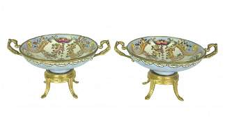 A pair of French style porcelain gilt metal mounted ped