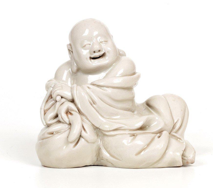 A rare Chinese Dehua figure of Budai, late Ming/early Q