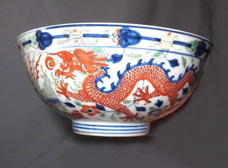 A Chinese Imperial wucai enamel dragon and phoenix bowl
