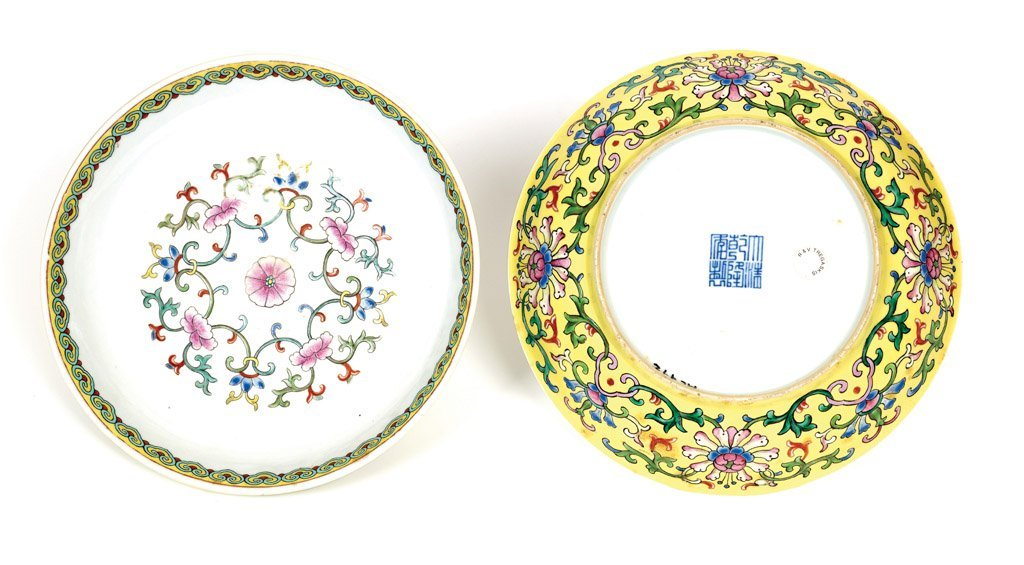 A rare pair of Chinese Imperial famille-rose saucer dis