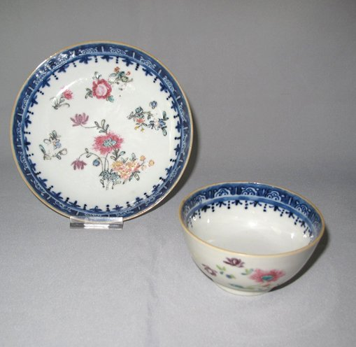 A Chinese famille-verte teabowl and saucer, Kangxi 1662