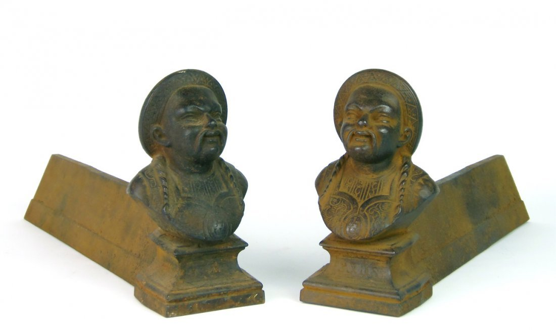 A pair of cast iron andirons in the form of Chinese gen