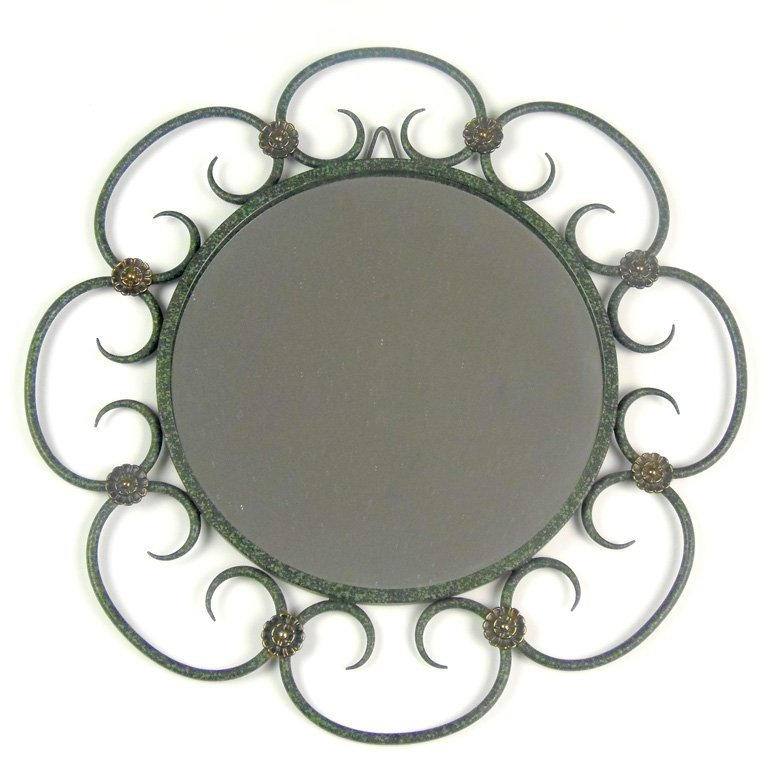 A fine wrought iron and bronze circular wall mirror, It