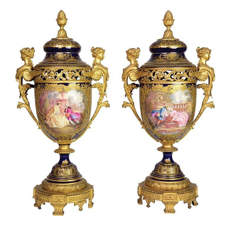 A pair of fine Sevres pattern porcelain covered vases,