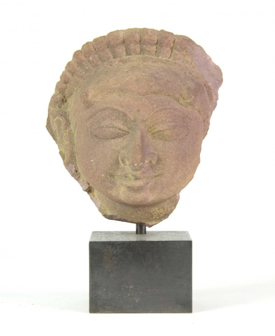 An unusual Indian pink sandstone head, Indian 9th/10th