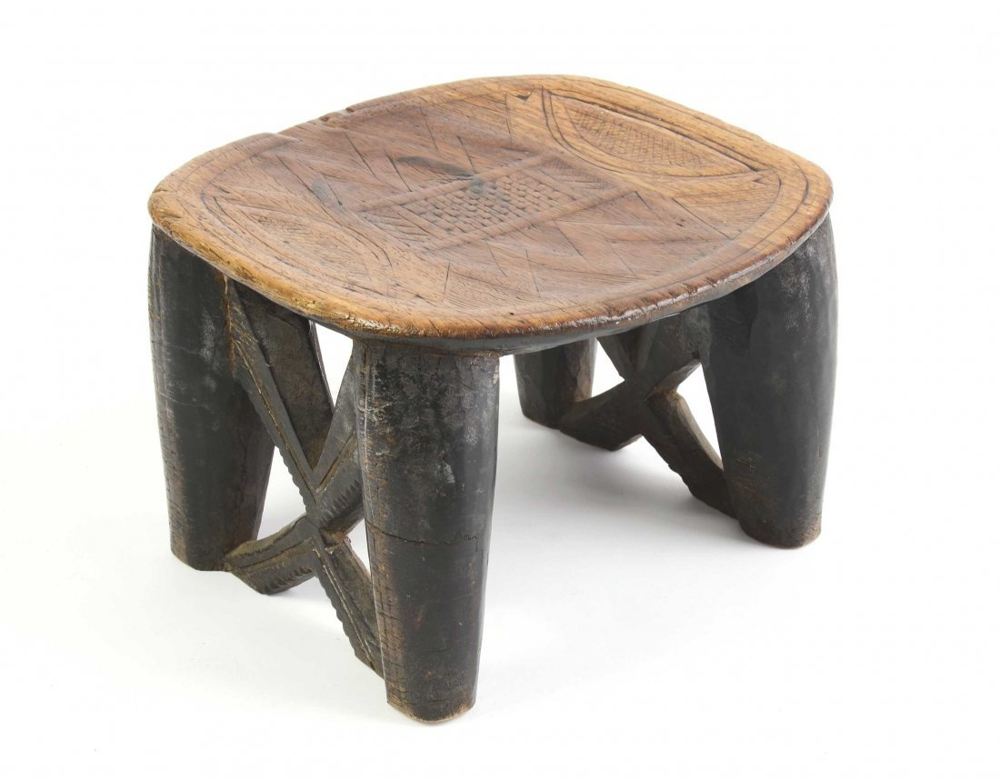 A well patinated African Chief's stool 19cm high, 28cm