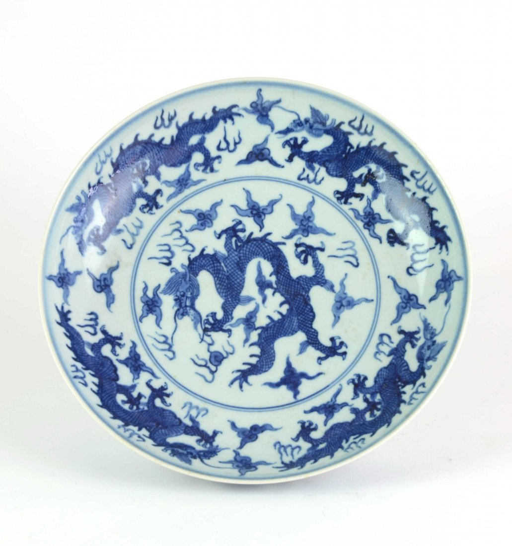 A Chinese blue and white porcelain dragon dish Ming rei