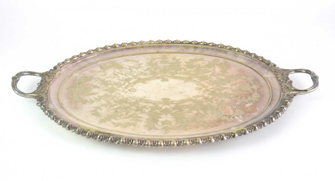 A silver plated oval drinks tray, 19th century 74cm wid