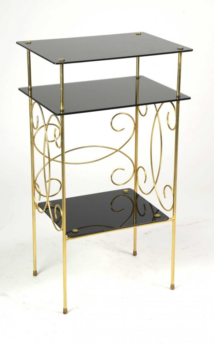 A black glass and gilt metal étagère French Circa 1940
