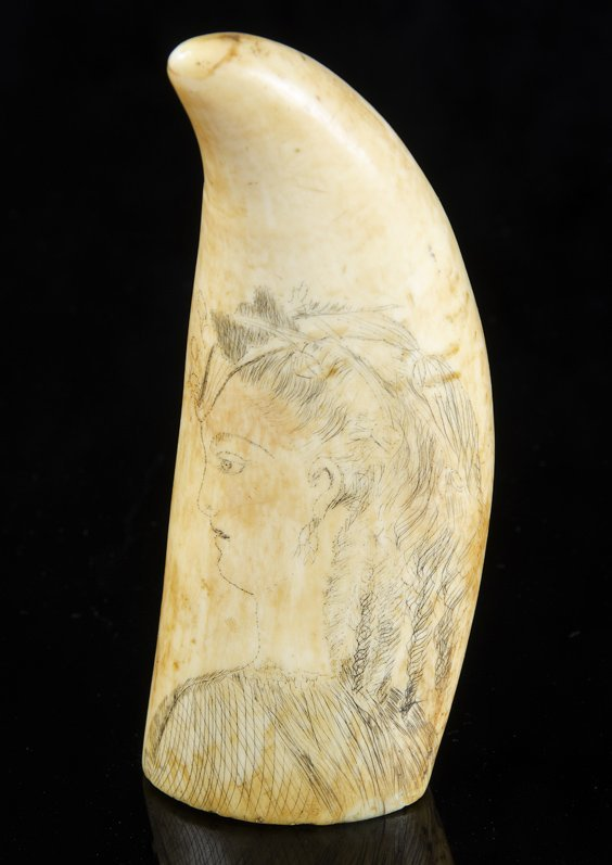 A Scrimshaw whales tooth, 19th century  decorated with