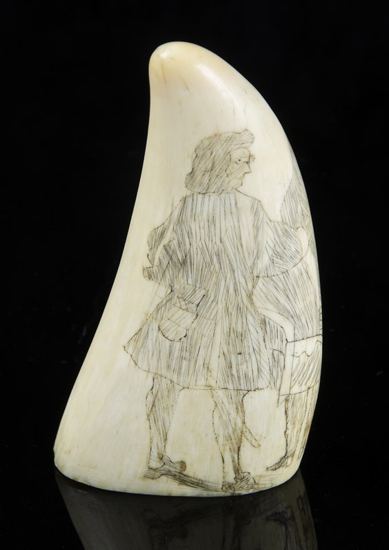 A Scrimshaw whales tooth, 19th century decorated with a