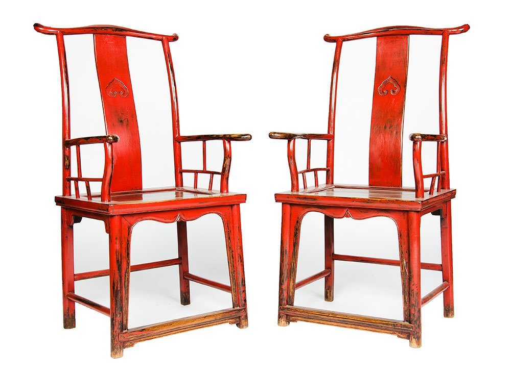 A pair of red-lacquered Chinese yolk back armchairs, 20