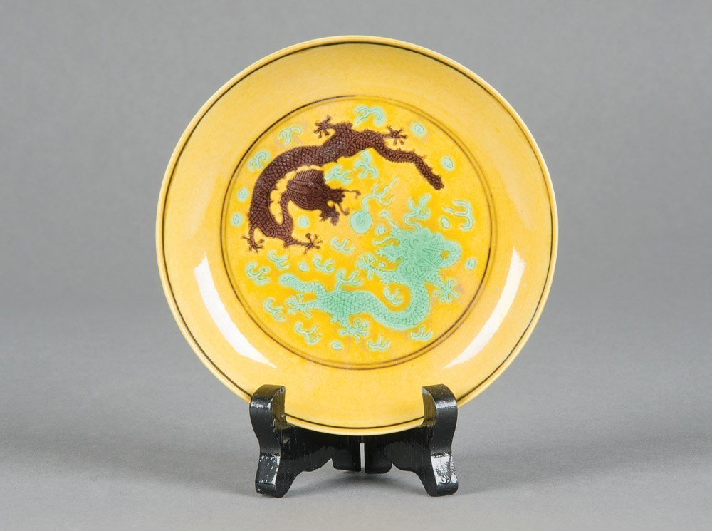 A Chinese yellow, green and aubergine dragon dish, Tong