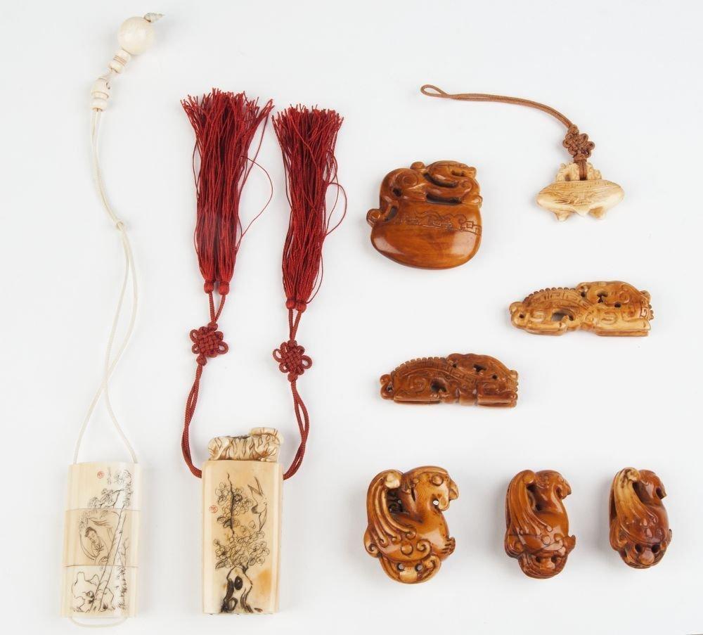 Group of bone & ivory netsuke (3), amulets (4), seal &