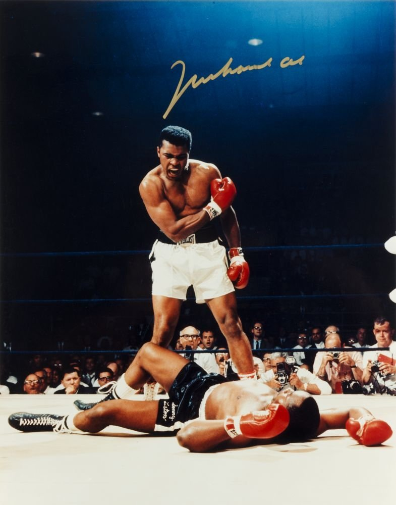 MUHAMMAD ALI, signed colour photograph of Ali standing
