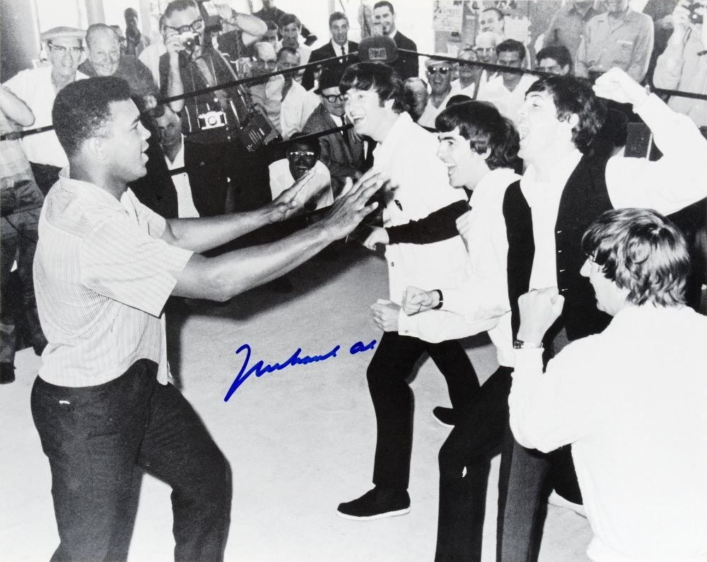 MUHAMMAD ALI & THE BEATLES, photograph of Ali clowning